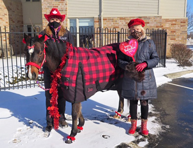 Colleen Lindsay-Druyff and Marjorie Lindsay stand with Boni the horse.