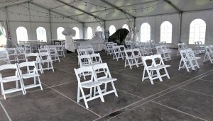 The large tent at Links at Dover Coast is set up with seating for Lighthouse Theatre plays this summer.