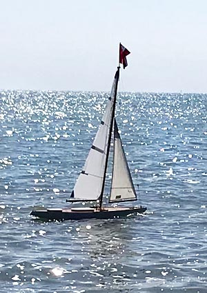 The J Class model under sail on the lake.